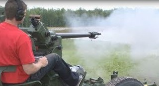 Firing A 40mm Machine Gun